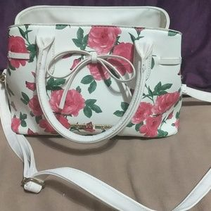 White and floral Christian siriano purse